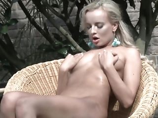 Attractive Blonde Plays With Golden Electro-hitachi In Backyard